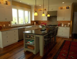 warm and cozy kitchen with brick backsplash